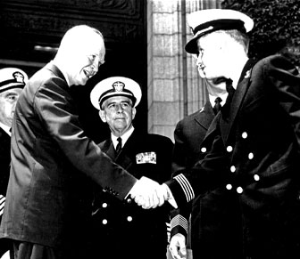 Ross Perot shaking hands with President Dwight D. Eisenhower