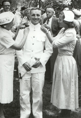 Ross Perot at his Navy pinning with his mother and wife