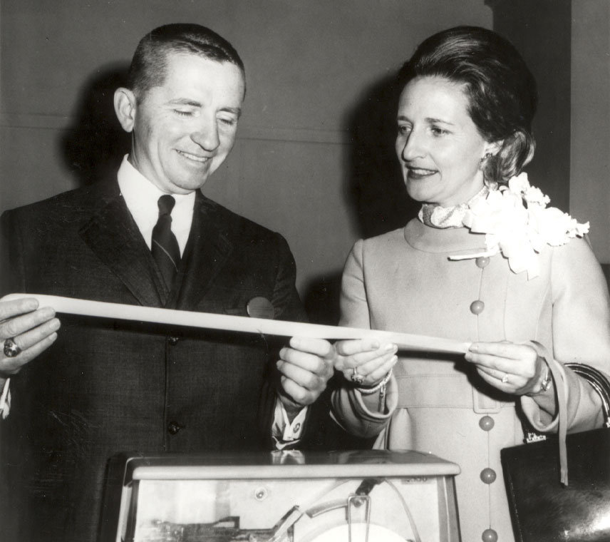 Ross and Margot Perot holding ticker tape from EDS