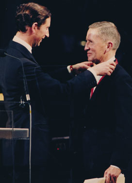 Britain's Prince Charles putting the Winston Churchill Award medal on recipient Ross Perot